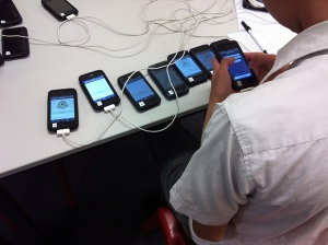 student coordinating iphones for the game
