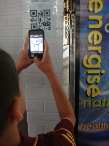 student scanning QR code